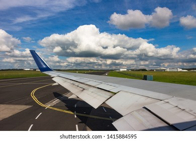 Looking out over Shannon airport runway from aircraft taxiing on runway