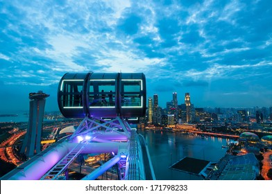 Looking out over the Singapore cityscape in early evening from the deck of the Singapore Flyer.
