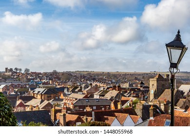 Looking out over the   town of Lewes in East Sussex, with the castle visible on the horizon in the distance