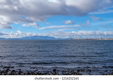 Looking out from Stevenston foreshore to Saltcoats and Ardrossan with Arran in the hazy distance.