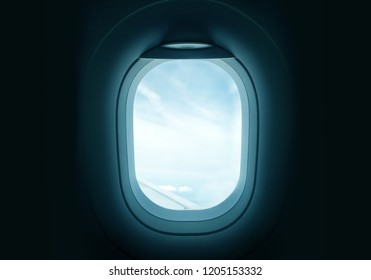 Looking out through an airplanes porthole window during a flight.