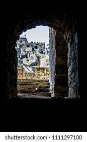 Looking out through an Arch Opening towards the Top of Golconda Fort in Hyderabad, India