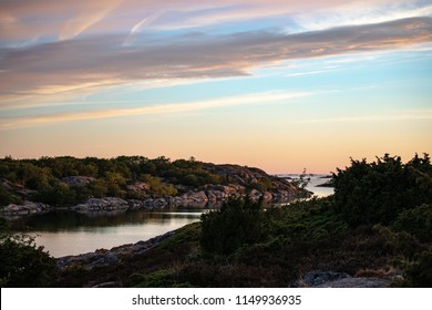 Looking out towards the pastel cloud-streaked sky above the Baltic a few minutes before sunset, from Kökar, a municipality of the Åland Islands, Finland, in midsummer.