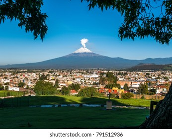 Looking out to Volcan Popocatapetl from a hill in the city of Puebla on a clear morning.