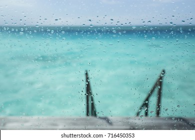 Looking out the window on a rainy day in Maldives
