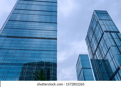 Looking up at the outer wall of glass building of high-rise building