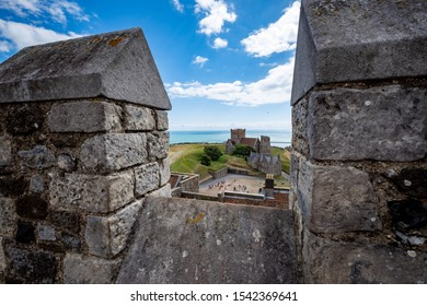 Looking over battlements at Dover Castle, England, UK with English flag flying