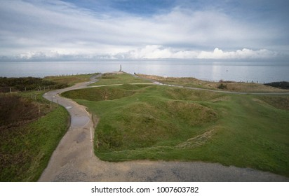 Looking over the bomb-cratered land at Pointe du Hoc, France. Securing these German bunkers and gun emplacements was a primary objective for American General Dwight Eisenhower on D-Day.