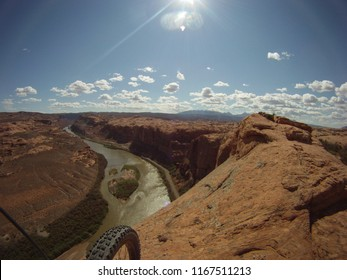 e4b61c7e7ff4 Looking over a mountain bike tire to the Colorado River below the Slick Rock  trail in