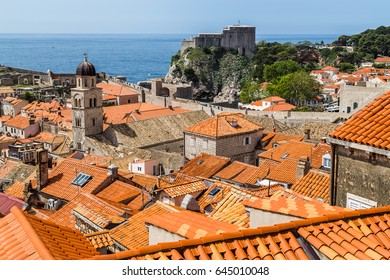 Looking over the orange terracotta rooftops of Dubrovniks old town from a high vantage point on the city walls.