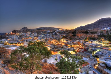 Looking over the rooftops of Lindos village at twilight in high dynamic range