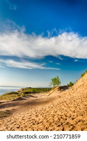 Looking over sand dunes along side  Lake Michigan on a summer day.