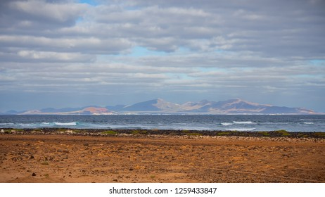 Looking over the sea on to the Lanzarote island from nothernmost part of Fuerteventura, Spain.