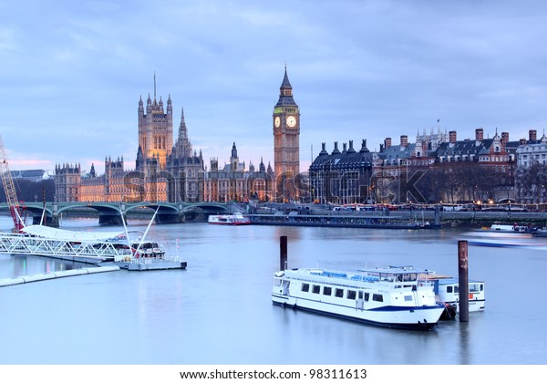 Looking over the Thames to The Houses of Parliament and Big Ben at dusk
