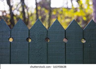 Bikini through the wooden fence