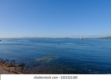 Looking over from Wemyss bay Pier to the Arran hills in the far hazy distance in a bright October day.