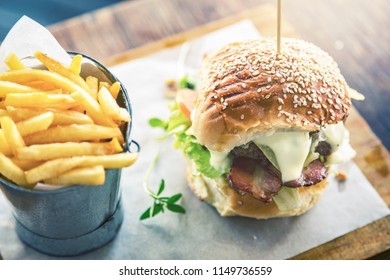 Looking own at an upmarket luxury burger with chips at an aspirational restaurant.