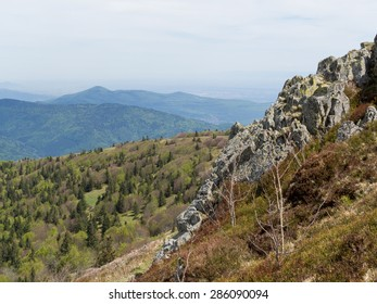 Looking past a cliff edge at the Vosges hills in France