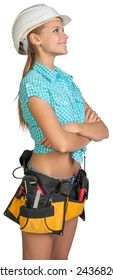 Looking up pretty girl in helmet, shorts, shirt and tool belt with tools standing with crossed arms. Isolated over white background