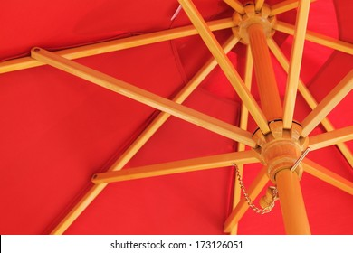 Looking up at a red sun umbrella