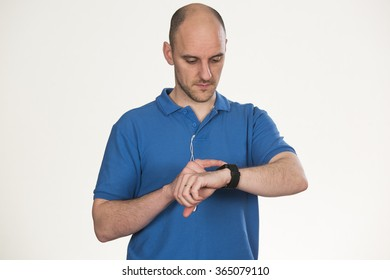 looking at route on his smart watch