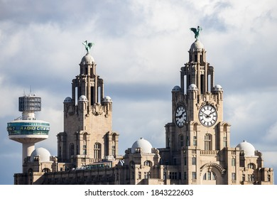 Looking up at the Royal Liver Building in Liverpool from the promenade across the River Mersey in Seacombe in October 2020.