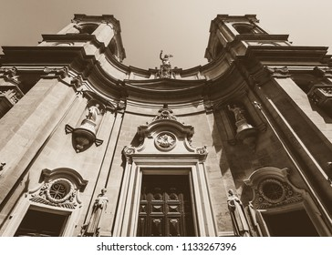 Looking up Saint Dominic Church Valletta Malta, Low angle high contrast sepia tone summer 2018 Baroque architecture