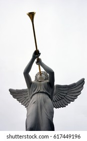 Looking up at sculpture of angel blowing horn
