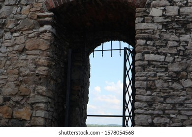 looking sky at the iron doors of an ancient castle