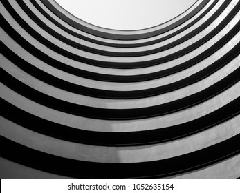 Looking up to sky from modern circle concrete building,Abstract layer of curve architecture