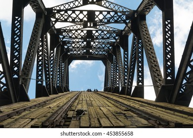Looking up to the sky through the raised wood and metal railway bridge.  Chicago, Illinois, U.S.A..
