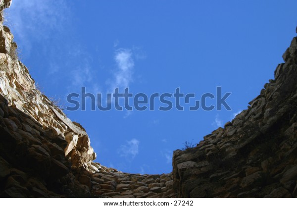 Looking at the sky through the roof of a ruin