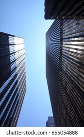 Looking up to the sky. View from below of skyscrapers in New York.