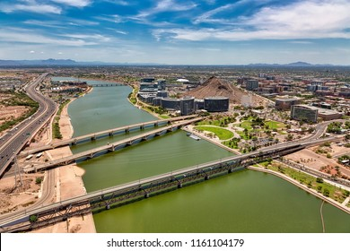 Looking southeast from above the Tempe Town Lake showing bridges and growth in this once sleepy college town in Arizona