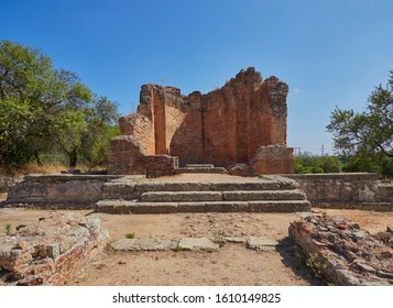 Looking up the steps towards the Water Temple at the Roman ruins of Milreu in the town of Estoi on the Algarve of Portugal.