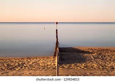 Looking straight down the Groyne at Bournemouth in the early part of the morning.
