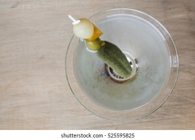 Looking straight down on a Vodka or Gin Martini with fancy garnish.
