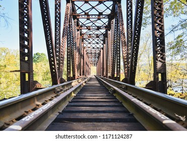 Looking straight down the tracks on a train bridge
