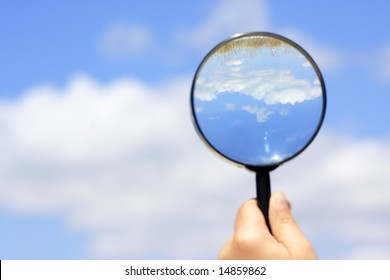 looking for the summer. landscape view through magnifying glass