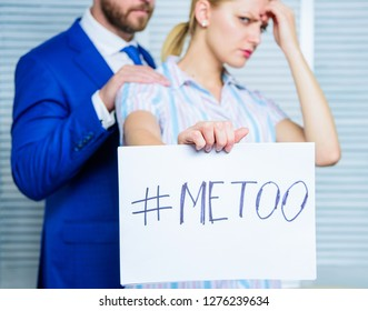 Looking for support. Discrimination assault complaint. Victim assault at workplace. Assault targeted at employee. Girl hold poster hashtag me too while colleague calm down her. Share assault story.