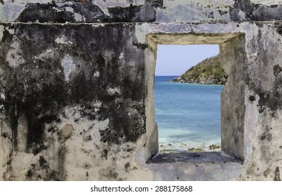Looking though the window of an abandoned sugar mill in St. John, US Virgin Islands.   Looking at an island in the distance.