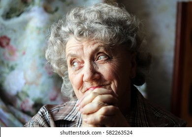 Looking and thoughtful grandmother portrait with hands