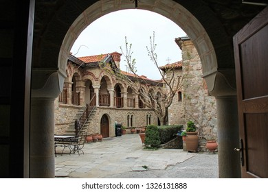 Looking Through An Archway at a Courtyard in St. Stephen's Monastery, Meteora