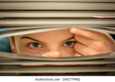 looking through the blinds