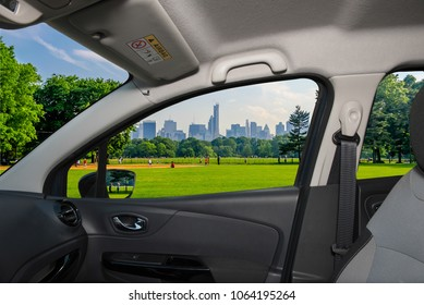 Looking through a car window with view of Central Park and a beautiful contrast between skyscrapers and buildings, Manhattan, New York City, USA