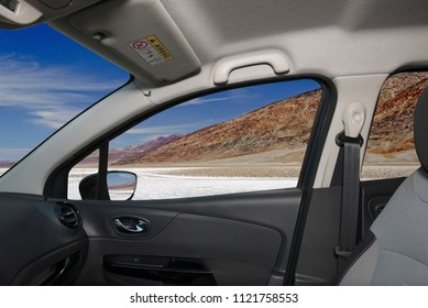 Looking through a car window with view of Badwater Basin, the lowest elevation point in USA, Death Valley National park in California