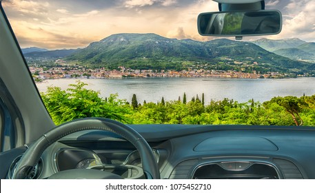 Looking through a car windshield with view of the town of Salo, on the Lake Garda, Italy