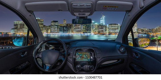 Looking through a car windshield with view over Manhattan skyline at night, New York City, USA