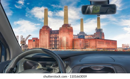 Looking through a car windshield with view of Battersea Power Station, iconic landmark in London, UK
