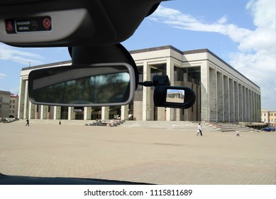 Looking through a dashcam car camera installed on a windshield with view of the Palace of the Republic, Minsk, Belarus